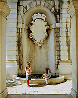 The fountain in the courtyard of the Ca' Rezzonico palazzo, Venice. Designed by Baldassare Longhena in 1667, the fountain is topped with the crest of the Rezzonico family. The palazzo is now a museum dedicated to the 18th century in Venice.
