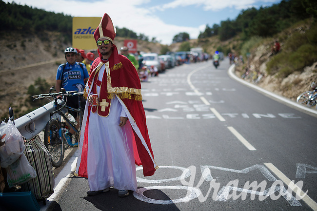 the race was blessed by a party pope<br /> <br /> stage 20: San Lorenzo de el Escorial - Cercedilla (176km)<br /> 2015 Vuelta à Espana