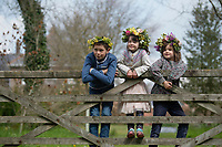 BNPS.co.uk (01202 558833)<br /> Pic: ZacharyCulpin/BNPS <br /> <br /> Weather input - <br /> <br /> Crowning glories: Dorset Flower Farmers, the Priestley family perfect their flower crown-making ahead of Garden Day on Sunday 9th May, the nationwide celebration of the benefits of gardens for health and wellbeing.  <br /> <br /> Pictured: Siblings Milo, 9, and Arabella, 5, Isadora Priestley. 7 show off their flower crowns in the ?garden<br /> <br /> Garden Day will be back for a third successive year on Sunday, 9th May 2021 to celebrate outdoor and indoor garden spaces. The nationwide  movement is calling on plant-lovers to make a flower crown, and share their plant spaces with family and<br /> friends