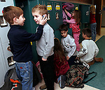 TORRINGTON, CT05 January 2006-010506TK07 (left to right:) First graders Tom Brennan and Kyle Price share conversation as classmate explore the space in their new lockers for the first time in a portion of the new renovation of the Torringford School.  The second portion of the school renovation program is scheduled to be completed in the summer.   Tom Kabelka / Republican-American (Tom Brennan, Kyle Price, Torringford School)CQ