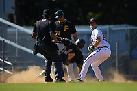 Danville Braves third baseman Brendan Venter (56) checks the runner at first after tagging out Jonah Davis (14) of the Bristol Pirates at American Legion Post 325 Field on July 1, 2018 in Danville, Virginia. The Braves defeated the Pirates 3-2 in 10 innings. (Brian Westerholt/Four Seam Images)