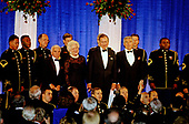 United States President George H.W. Bush and First lady Barbara Bush prepare to depart the American Film Institute (AFI) Gala in Washington, DC on September 26, 1989.  Jack Valenti, president, Motion Picture Association of America (MPAA), is pictured to the immediate left of Mrs. Bush.<br /> Credit: Ron Sachs / CNP