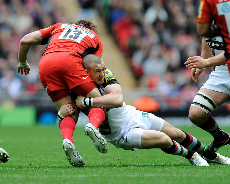 Mike Brown of Harlequins tackles Chris Wyles of Saracens during the Aviva Premiership match between Saracens and Harlequins at Wembley Stadium on Saturday 31st March 2012 (Photo by Rob Munro)
