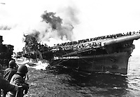 USS SANTA FE lays alongside of USS FRANKLIN rendering assistance after carrier had been hit and set afire by a Japanese dive bomber.  March 1945.  (Navy)<br /> Exact Date Shot Unknown<br /> NARA FILE #:  080-G-273880<br /> WAR & CONFLICT BOOK #:  979