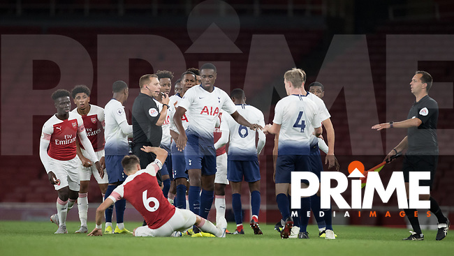 Scuffle and Julio Pleguezuelo of Arsenal goes to ground as Troy Parrott of Tottenham Hotspur is sent off during the Premier League 2 match between Arsenal U23 and Tottenham Hotspur U23 at the Emirates Stadium, London, England on 31 August 2018. Photo by Andy Rowland.