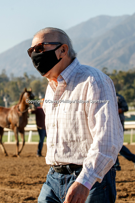 ARCADIA, CA  MARCH 6: #6 Brickyard Ride's trainer Craig Lewis entering the winners circle after winning the San Carlos Stakes (Grade ll) on March 6, 2021 at Santa Anita Park in Arcadia, CA.  (Photo by Casey Phillips/EclipseSportswire/CSM)