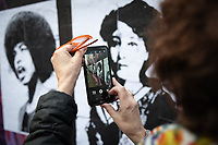 MADRID, SPAIN – MARCH 08: A woman takes a photograph of the intervention that people have made to protest the vandalization of the feminist mural in front of the feminist mural that has been sabotaged the night before 8M in the Ciudad Lineal neighborhood on 8 march in Madrid, Spain. Various demonstrations and protests have been carried out to celebrate and commemorate the international day of working women that is celebrated every year on March 8. (Photo by Joan Amengual / VIEWpress via Getty Images)
