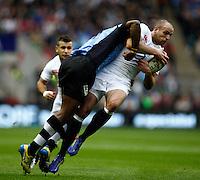 Photo: Richard Lane/Richard Lane Photography. England v Fiji. QBE Autumn Internationals. 10/11/2012. England's Charlie Sharples is tackled by Fiji's Watisoni Votu.