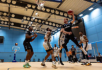 Cameron Hildreth of Surrey Scorchers drives under the basket during the BBL Championship match between Surrey Scorchers and Newcastle Eagles at Surrey Sports Park, Guildford, England on 20 March 2021. Photo by Liam McAvoy.