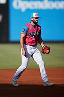 Pescados de Carolina third baseman Alex Binelas (2) on defense against the Delmarva Shorebirds at Five County Stadium on September 4, 2021 in Zebulon, North Carolina. (Brian Westerholt/Four Seam Images)