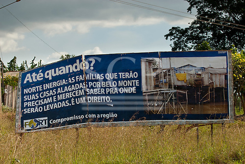 """Altamira, Para State, Brazil. Agrovila do km 18. FORT Xingu advertising hoarding which says """"Until When? Norte Energia: The families which will have their houses flooded by Belo Monte need and deserve to know where they are going to be taken to. That is their right."""""""