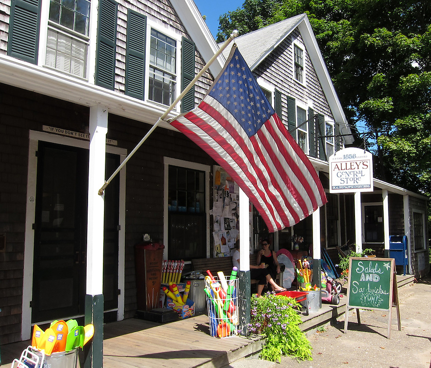 An American flag hangs in front of Alleys General Store on Martha's Vineyard, Massachusetts.