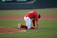 Starting pitcher Alex Scherff (18) of the Greenville Drive takes a moment at the mound before a game against the Rome Braves on Saturday, April 20, 2019, at Fluor Field at the West End in Greenville, South Carolina. Rome won, 5-4. (Tom Priddy/Four Seam Images)