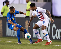 PHILADELPHIA, PA - JUNE 30: Weston Mckennie #8 and Kenji Gorre #14 vie for the ball during a game between Curaçao and USMNT at Lincoln Financial Field on June 30, 2019 in Philadelphia, Pennsylvania.