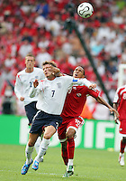 Densil Theobald of Trinidad pushes aside David Beckham of England. England defeated Trinidad & Tobago 2-0 in their FIFA World Cup group B match at Franken-Stadion, Nuremberg, Germany, June 15 2006.