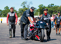 Aug 18, 2019; Brainerd, MN, USA; NHRA top fuel nitro Harley Davidson motorcycle rider Doug Vancil and crew during the Lucas Oil Nationals at Brainerd International Raceway. Mandatory Credit: Mark J. Rebilas-USA TODAY Sports