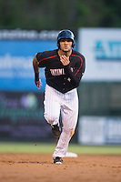 Nick Basto (14) of the Kannapolis Intimidators takes off for third base during the game against the West Virginia Power at Intimidators Stadium on July 3, 2015 in Kannapolis, North Carolina.  The Intimidators defeated the Power 3-0 in a game called in the bottom of the 7th inning due to rain.  (Brian Westerholt/Four Seam Images)