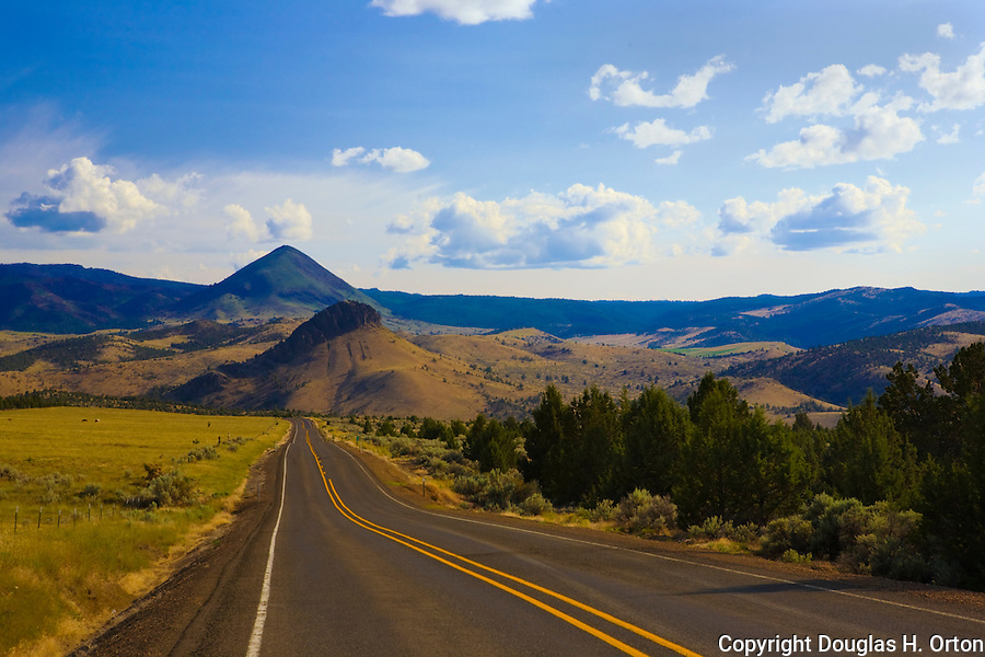 Oregon Highway 207 looking south approaching Mitchell, OR and the Painted Hills division of John Day Fossile Beds National Monument contains not just stunningingly beautiful landscapes and interesting geologic history, but also tranquil peace and quiet.