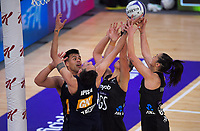 Players compete for a rebound during the Cadbury Netball Series final between NZ Silver Ferns and NZ Men at the Fly Palmy Arena in Palmerston North, New Zealand on Saturday, 24 October 2020. Photo: Dave Lintott / lintottphoto.co.nz
