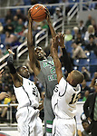 Green Valley's Durrell McDonald shoots over Hug defenders Norris Dupree, left, and Andrew Johnson during a semi-final game in the NIAA 4A State Basketball Championships between Hug and Green Valley high schools at Lawlor Events Center in Reno, Nev, on Thursday, Feb. 23, 2012. Hug won 70-68..Photo by Cathleen Allison