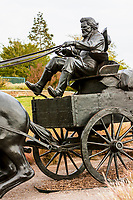 Oklahoma City, Oklahoma.  Oklahoma Land Run Monument, Sculptor Paul Moore.  Wagon Driver, Teamster.