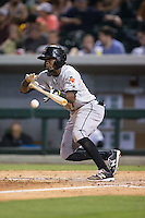 Alen Hanson (7) of the Indianapolis Indians lays down a bunt against the Charlotte Knights at BB&T BallPark on June 17, 2016 in Charlotte, North Carolina.  The Knights defeated the Indians 4-0.  (Brian Westerholt/Four Seam Images)