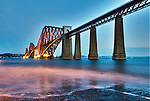 Waves on the Hawes Pier with the Forth Rail Bridge as a back drop