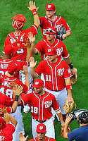 25 September 2011: Washington Nationals third baseman Ryan Zimmerman (11) celebrates with teammates after a game against the Atlanta Braves at Nationals Park in Washington, DC. The Nationals shut out the Braves 3-0 to take the rubber match third game of their 3-game series - the Nationals' final home game for the 2011 season. Mandatory Credit: Ed Wolfstein Photo