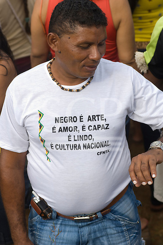 """Altamira, Brazil. """"Xingu Vivo Para Sempre"""" protest meeting about the proposed Belo Monte hydroeletric dam and other dams on the Xingu river and its tributaries. Black movement CFNTX t-shirt."""