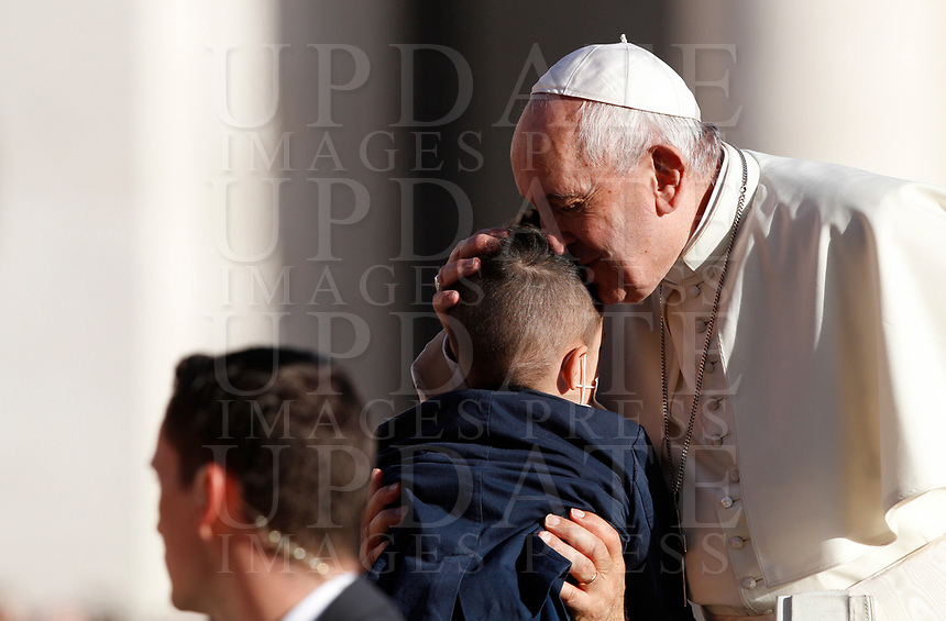 Pope Francis kisses a child as he arrives to attend the weekly general audience in St. Peter's Square at the Vatican City, October 16, 2019. UPDATE IMAGES PRESS/Riccardo De Luca<br /> <br /> STRICTLY ONLY FOR EDITORIAL USE