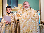 Pascal greetings from the Patriarch are read and translated during Paschal Divine Liturgy with the blessing of the eggs, St. Sava Serbian Orthodox Church, midnight in Jackson, Calif.
