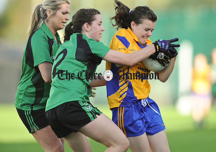 Grainne Nolan of The Banner in action against Eva Dunne and Sinead Cotter of St Valentine's during their Senior Ladies Munster football final at Kilmallock. Photograph by John Kelly.