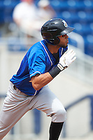 Biloxi Shuckers second baseman Yadiel Rivera (13) runs to first during the first game of a double header against the Pensacola Blue Wahoos on April 26, 2015 at Pensacola Bayfront Stadium in Pensacola, Florida.  Biloxi defeated Pensacola 2-1.  (Mike Janes/Four Seam Images)