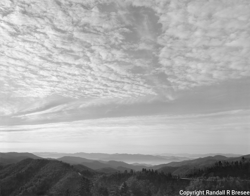 """""""Morning Sky At Newfound Gap"""" <br /> Great Smoky Mountains National Park, North Carolina<br /> <br /> I was driving at higher elevations in the Great Smoky Mountains National Park when the bottoms of clouds became illuminated by the low position of the early morning sun. I quickly exposed a black and white film near the Newfound Gap parking lot on Highway 441 and it captured the scene nicely."""