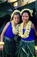 Young hula dancers with ti leaf skirts and plumeria leis