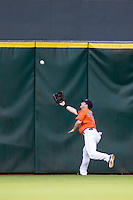 Houston Astros outfielder Robbie Grossman (19) makes a nice running catching in the first inning of the MLB baseball game against the Detroit Tigers on May 3, 2013 at Minute Maid Park in Houston, Texas. Detroit defeated Houston 4-3. (Andrew Woolley/Four Seam Images).