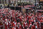 SantaCon meet up outside Liverpool Street Station central city of London UK 2015.