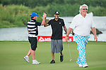 John Daly (blue pants), Robbie Fowler (in stripes) and Allen Iverson (black shirt) at the end of their game during the World Celebrity Pro-Am 2016 Mission Hills China Golf Tournament on 23 October 2016, in Haikou, Hainan province, China. Photo by Marcio Machado / Power Sport Images