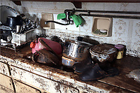 Pictured: Salvaged items from a flooded property are gathered in a sink.<br />