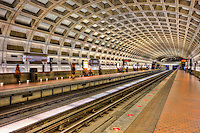 Passengers wait for the next train to arrive at the Farragut West station of the Washington DC metro.