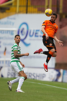 22nd August 2020; Tannadice Park, Dundee, Scotland; Scottish Premiership Football, Dundee United versus Celtic; Nicky Clark of Dundee United wins the header from Nir Bitton of Celtic