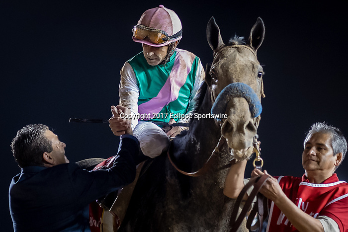 DUBAI, UNITED ARAB EMIRATES - MARCH 25: Mike Smith atop Arrogate #9, gets congratulated by Assistant trainer Jimmy Barnes, after winning the Dubai World Cup at Meydan Racecourse during Dubai World Cup Day on March 25, 2017 in Dubai, United Arab Emirates. (Photo by Douglas DeFelice/Eclipse Sportswire/Getty Images)