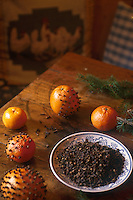 Oranges are decorated with cloves in the creation of pomanders, the traditional scent of Christmas