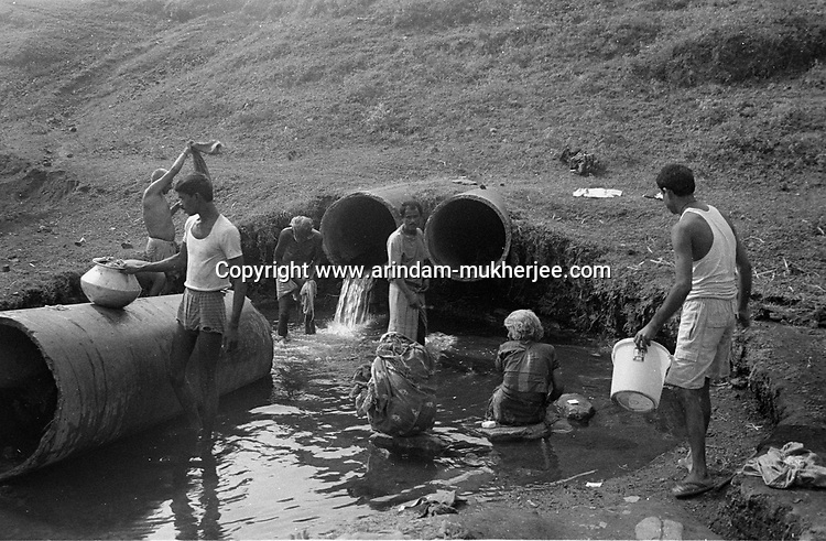 Local people in a colliery basti (slum) using water coming out of a mine contamineted with different chemicals as scarcity of pure water is a big problem in the coal mining area in and around Jharia, Jharkhand, India. Arindam Mukherjee