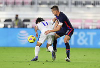 FORT LAUDERDALE, FL - DECEMBER 09: Aaron Long #3 of the United States puts the squeeze on Joaquin Rivas #11 of El Salvador during a game between El Salvador and USMNT at Inter Miami CF Stadium on December 09, 2020 in Fort Lauderdale, Florida.