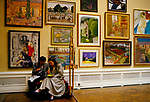 The Royal Academy Summer Exhibition  London UK.  1980s. Varnishing Day, the day artists can check their work is hung correctly etc and they get lunch. 1984.