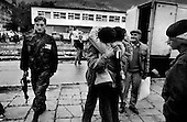 Travnic, Bosnia<br /> 1993<br /> <br /> Bosnian refugees, fleeing the ethnic war in the former Yugoslavia, arrive at an old school house to sleep under the guard of the United Nations.