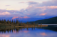 Alaska Range, clouds & water in pink light, Denali National Park. Alaska United States Denali National Park.