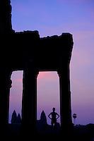 Tourist watching the sunrise over Angkor Wat, cambodia