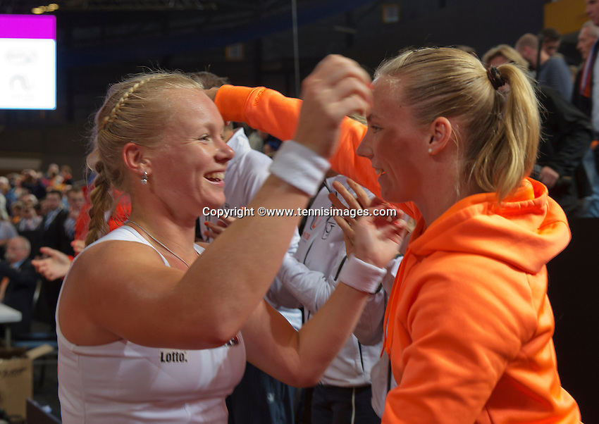 Februari 08, 2015, Apeldoorn, Omnisport, Fed Cup, Netherlands-Slovakia, Kiki Bertens (NED) is congratulated by captain by het team members, she puts the Netherlands in the lead 2-1<br /> Photo: Tennisimages/Henk Koster